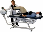 Traction package with electric elevation treatment table